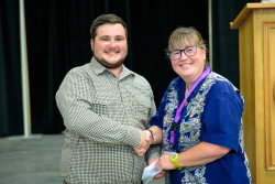 Joey Moore received an award for the best poster presentation in the Freshwater Sciences Section.