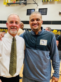 Clifton Ellis (right) stands with former men's basketball coach Kirby Johnson at Johnson's last g...