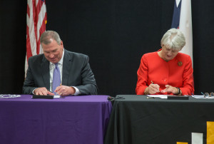 Temple College President Dr. Glenda O. Barron and UMHB President Dr. Randy O'Rear sign an articul...