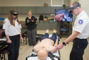 Diedra Blankenship (second from left) teaches paramedic students using an augmented reality syste...