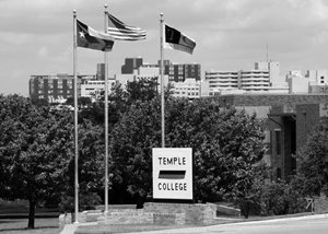 College with flags in front of building