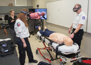 Paramedic students practice diagnosing a patient using the new augmented reality system.