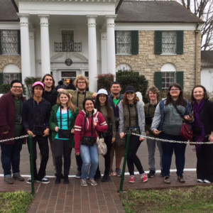 Trip participants pose for a photo in front of Graceland, which was the home of Elvis Presley.