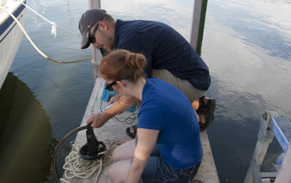 Devin Garcia and biology professor Jason Locklin conduct research on zebra mussels in Lake Belton.