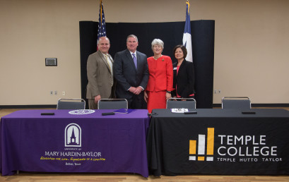 Representatives from UMHB and Temple College stand after signing an articulation agreement in July 2018. From left to right are Dr. John Vassar, provost and senior vice president for academic affairs at UMHB, Dr. Randy O'Rear, president of UMHB, Dr. Glenda O. Barron, president of Temple College; and Dr. Susan Guzman-Trevino interim vice president for academic affairs at Temple College.