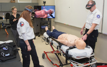 Paramedic students practice using the new augmented reality system.