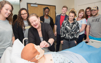 Claudia Turner with students in the Nursing Education Center.