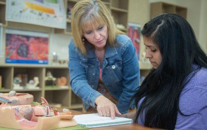 Nursing graduate Doris Dlouhy helps student Cecily Gonzales with her Anatomy and Physiology homework.