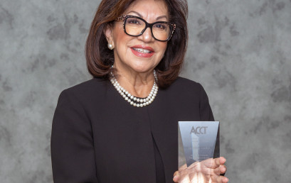 Lydia Santibañez displays the national award she received from the Association of Community College Trustees.