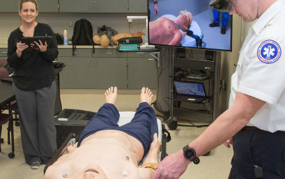Diedra Blankenship (second from left) teaches paramedic students using an augmented reality system.
