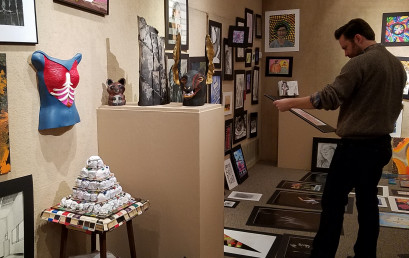 Baylor art professor Kyle Chaput judges entries in the 40th annual Central Texas Art Competition.