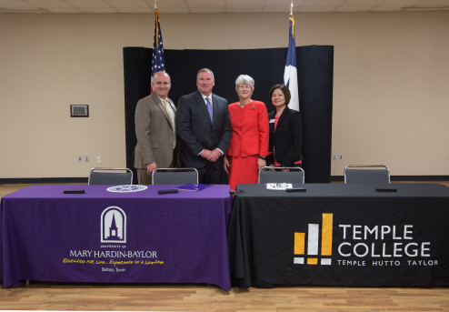 Representatives from UMHB and Temple College stand after signing an articulation agreement in Jul...