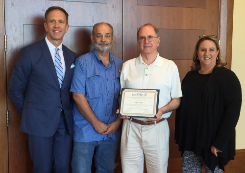 Dr. Bill Cornelius, director of the Respiratory Care program, holds the certificate Temple Colleg...