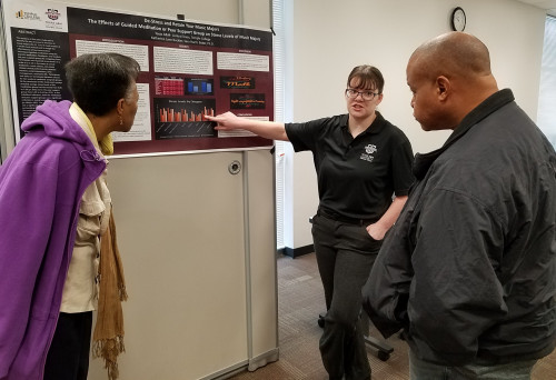 Music student Katherine Buckler talks with staff members Tina Marsh and Derrick Webb about her re...