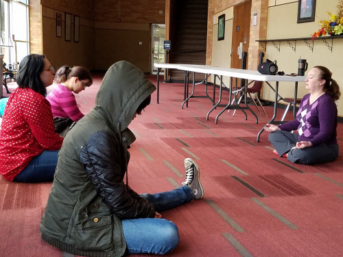 Music professor Dr. Sara Harris Baker leads students in a meditation session between classes.
